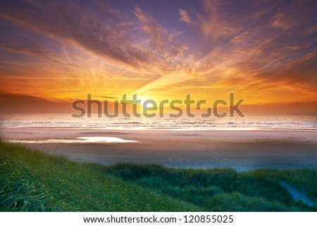 A sunset photo of ocean - stock photo