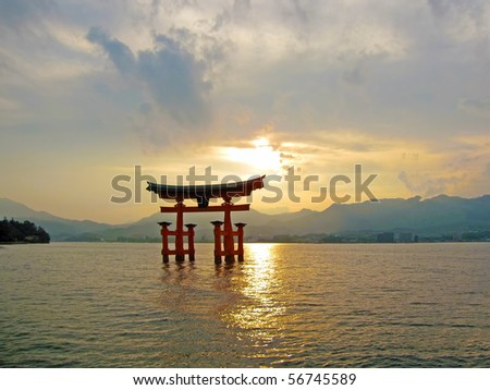 """A sunset view of the world heritage """"Floating Gate"""" near Hiroshima, Japan - stock photo"""