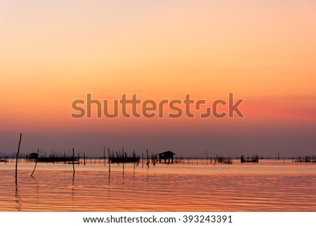 A sunset view with orange sky from Koh Yor, Songkhla, Thailand. - stock photo
