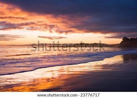 A sunset with dark clouds in Santa Barbara, California. - stock photo