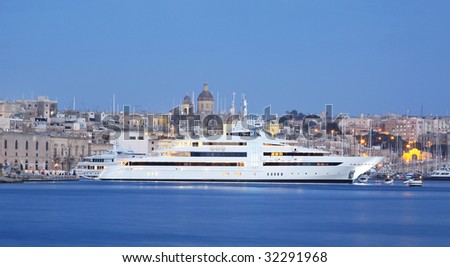 a super yacht berthed in a marina in malta - stock photo