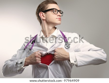 A superhero doctor is looking up, isolated on grey background