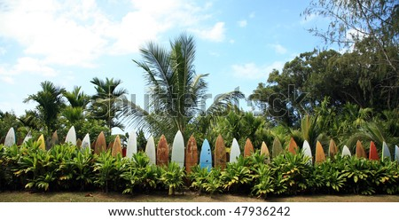 a surfboard fence - stock photo