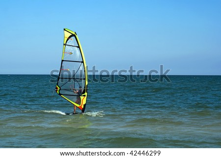 A surfer in the blue sea