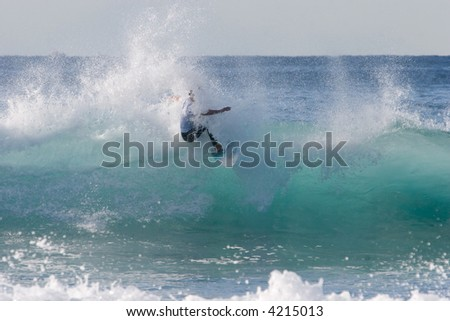 A surfer surfing the waves