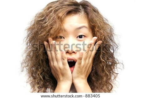 a surprised asian girl - stock photo