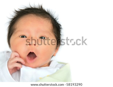A surprised newborn baby on a white background