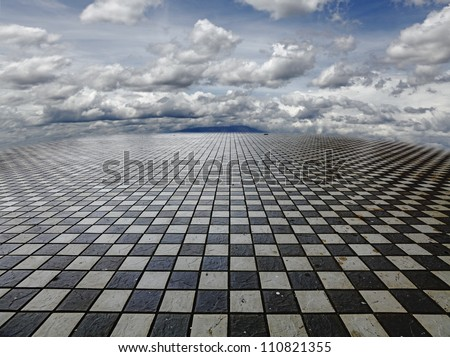 A surreal fantasy landscape of a vast checker matrix with mountains and clouds in the horizon. - stock photo