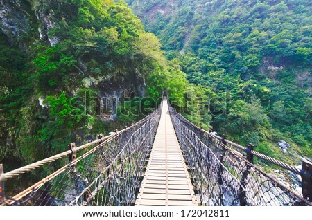 A Suspension Footbridge crossing Taroko Gorge National Park, Taiwan - stock photo