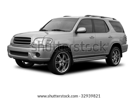 A SUV with tinted windows and cool wheels - stock photo