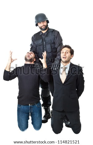 a swat agent arresting a burglar and a businessman - stock photo
