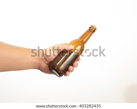 A sweaty male hand holding a bottle over a white background