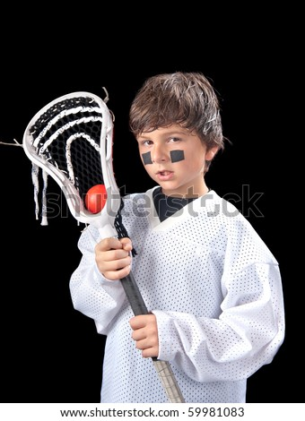 A sweaty young boy poses with his lacrosse stick (crosse) after a game. - stock photo