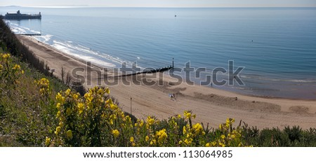 A sweeping panorama of Bournemouth Beach with the Pier to the left. - stock photo