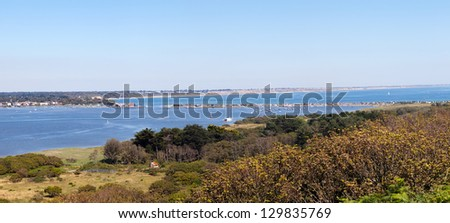 A sweeping panorama of the Mudeford sandspit from Hengistbury Head. - stock photo