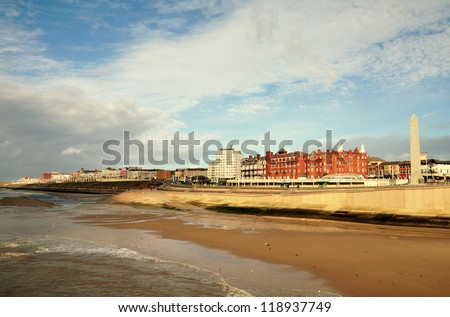 A sweeping panoramic view of the seafront at Blackpool, a popular seaside resort in Lancashire on a summers day. - stock photo
