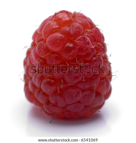 A sweet and tasty raspberry isolated on white