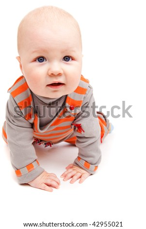 A sweet baby boy crawling, isolated - stock photo
