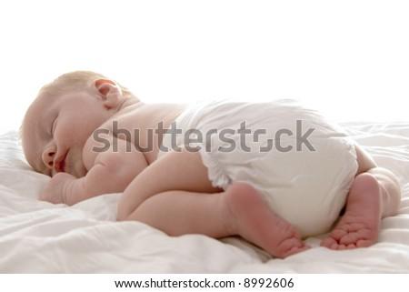 a sweet baby sleeping on a blanket - stock photo