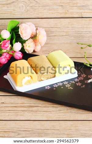 A sweet dessert of colorful on wooden background.