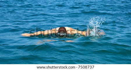 A swimmer in action in the sea - stock photo