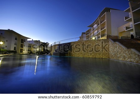 A swimming-pool and a modern building - Lifestyle concept - stock photo