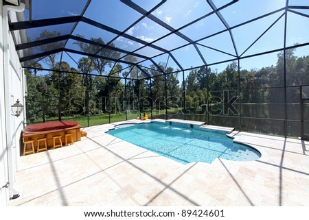 A Swimming Pool and Hot Tub with Lake View. - stock photo