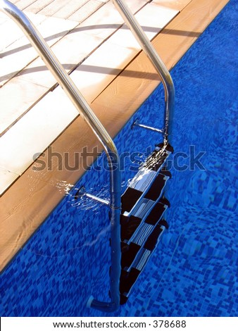 A Swimming Pool Ladder in Deep Blue Water