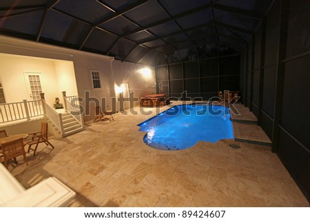 A Swimming Pool lit up at night - stock photo