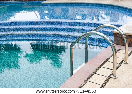 A swimming pool with steel stair. - stock photo