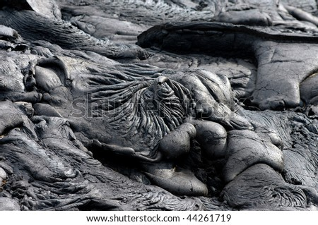 A swirled pool of lava has hardened in the Hawaii Volcanoes National Park on the Big Island of Hawaiil. - stock photo