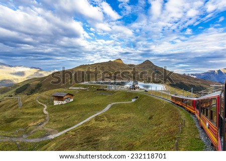 A Swiss train heading towards Jungfrau in Swiss Alps. - stock photo