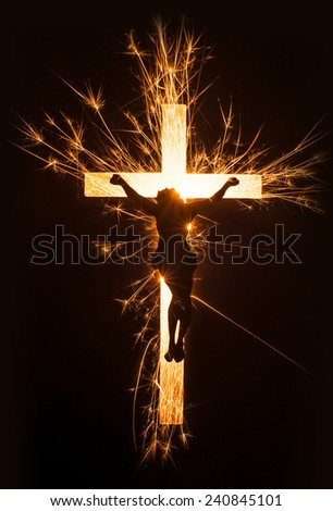 A symbol of Jesus on cross in sparkling glowing design on black background. - stock photo