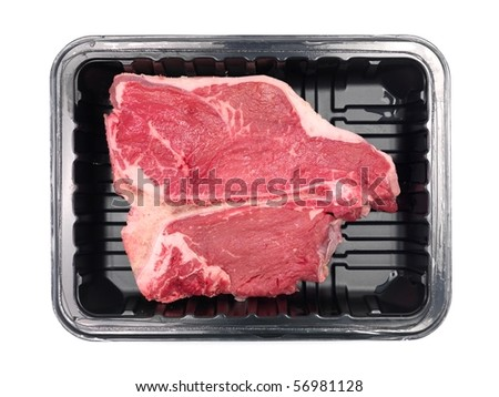 A T Bone steak in a plastic supermarket tray isolated against a white background