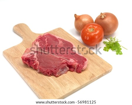A T Bone steak isolated against a white background - stock photo