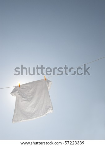 A t-shirt hanging on a clothesline - stock photo