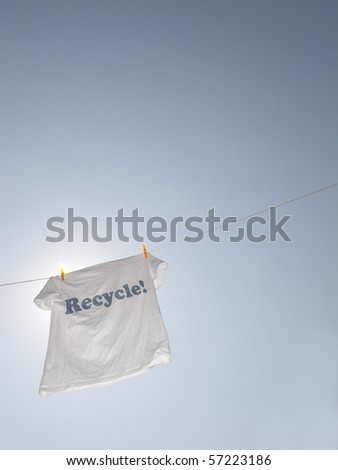 A t-shirt with the text recycle - stock photo