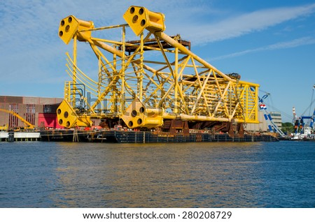 A 7400t steel jacket prepared to be shipped for installation in the port of Rotterdam-Netherlands. - stock photo