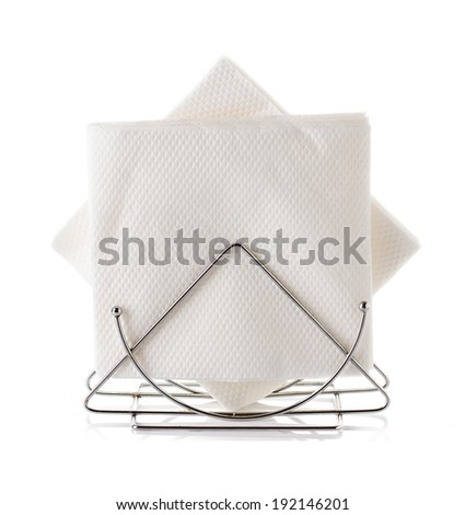 A table napkin holder with napkin, isolated on white - stock photo