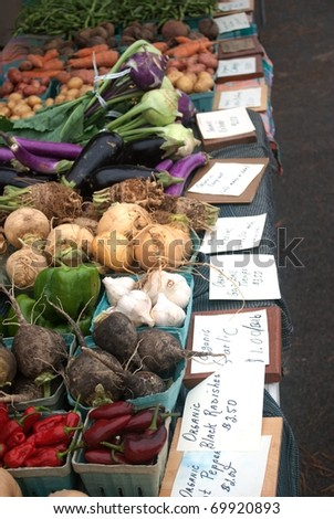 A Table of Assorted Vegetables at the Local Open Air Market - stock photo