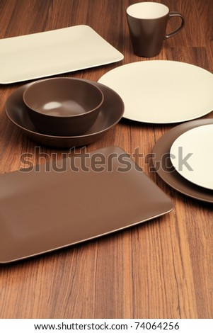 A table setting with different plates and a mug. - stock photo