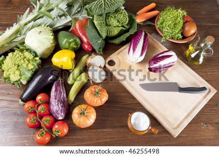 a table spread of fresh vegetables - stock photo