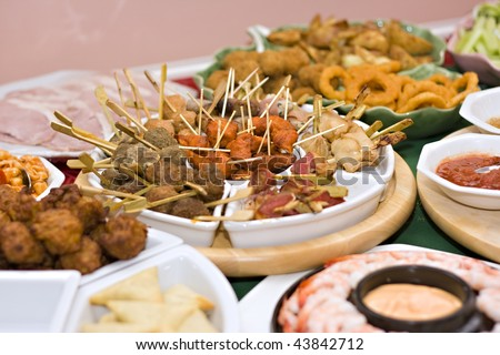 A table spread with delicious finger foods - stock photo