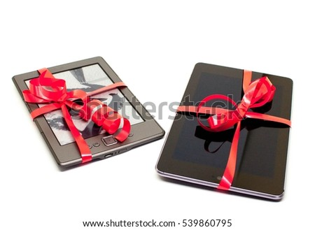 A tablet and an e-reader wrapped as christmas gifts with red curling ribbon on a white background