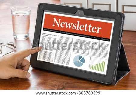 A tablet computer on a desk - Newsletter - stock photo