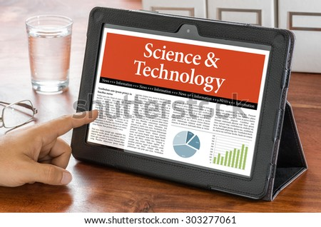 A tablet computer on a desk - Science and Technology - stock photo