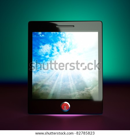 a tablet computer with separated sky on a screen - stock photo
