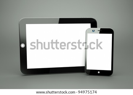 a tablet pc with modern cellphone on grey, - stock photo