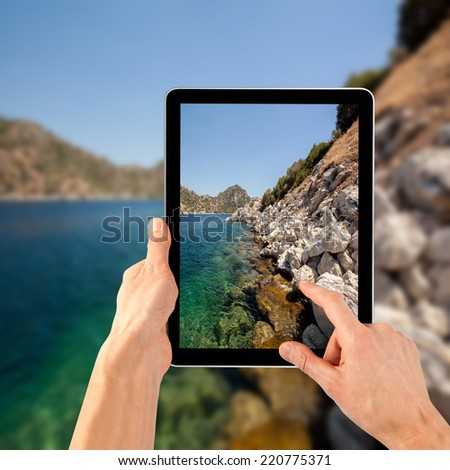 a tablet ps like on the sea backgrounds - stock photo