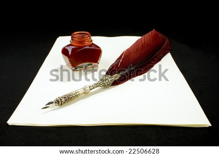 A Tabletop with a writing feather, an inkwell and paper - stock photo
